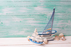 Decorative sailing ships and marine items on wooden background. Royalty Free Stock Images