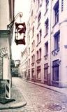 Decorative sand-clock in narrow street of the old Riga city, Latvia Stock Images