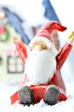 Decorative Santa Clause in snow. Decorative Santa Clause in front of a house on white background Royalty Free Stock Photography