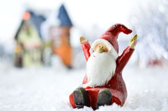 Decorative Santa Clause in snow. Decorative Santa Clause in front of a house on white background Royalty Free Stock Image