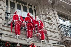 Decorative Santa Clauses on the balcony of the house royalty free stock images