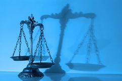 Decorative Scales of Justice. Symbol of law and justice with shadow, law and justice concept,blue tone Stock Photo