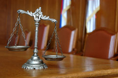 Decorative Scales of Justice. Symbol of law and justice on the table, law and justice concept, focus on the scales Stock Images