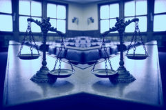 Decorative Scales of Justice. Two Scales of Justice in the empty courtroom, concept of double standards in justice, Blue tone Stock Photography