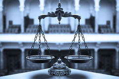 Decorative Scales of Justice. Symbol of law and justice in the empty courtroom, law and justice concept, blue tone Royalty Free Stock Image