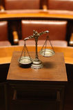 Decorative Scales of Justice in the Courtroom. Symbol of law and justice in the empty courtroom, law and justice concept Stock Image