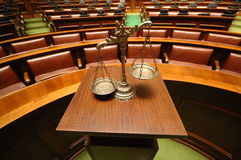 Decorative Scales of Justice in the Courtroom. Symbol of law and justice in the empty courtroom, law and justice concept Royalty Free Stock Photos