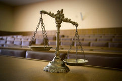 Decorative Scales of Justice in the Courtroom royalty free stock photography