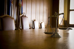 Decorative Scales of Justice in the Courtroom. Symbol of law and justice in the empty courtroom, law and justice concept Royalty Free Stock Image