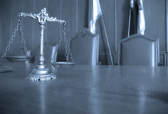 Decorative Scales of Justice in the Courtroom. Symbol of law and justice on the table, law and justice concept, focus on the scales, blue tone Royalty Free Stock Photo