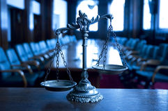 Decorative Scales of Justice in the Courtroom. Symbol of law and justice in the empty courtroom, law and justice concept, focus on the scales, blue tone Royalty Free Stock Photography