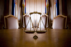 Decorative Scales of Justice in the Courtroom. Symbol of law and justice in the empty courtroom, law and justice concept Royalty Free Stock Images