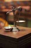 Decorative Scales of Justice in the Courtroom, Law and Justice c. Symbol of law and justice in the empty courtroom, law and justice concept Royalty Free Stock Photography