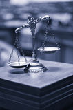 Decorative Scales of Justice in the Courtroom, Law and Justice c. Symbol of law and justice in the empty courtroom, law and justice concept. blue toned Stock Photo