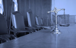 Decorative Scales of Justice in the Courtroom. Symbol of law and justice in the empty courtroom, BLUE TONE Royalty Free Stock Image