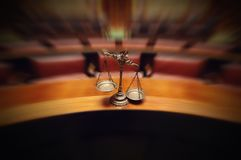Decorative Scales of Justice in the Courtroom. Symbol of law and justice in the empty courtroom, law and justice concept Royalty Free Stock Photo