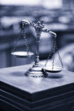 Decorative Scales of Justice in the Courtroom. Symbol of law and justice in the empty courtroom, law and justice concept, blue toned Royalty Free Stock Photos