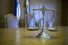 Decorative Scales of Justice in the Courtroom. Symbol of law and justice in the empty courtroom, law and justice concept, focus on the scales Royalty Free Stock Image