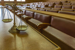 Decorative Scales of Justice in the Courtroom. Symbol of law and justice in the empty courtroom, law and justice concept, focus on the scales Royalty Free Stock Images