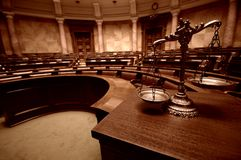 Decorative Scales of Justice in the Courtroom. Symbol of law and justice in the empty courtroom, law and justice concept Stock Images