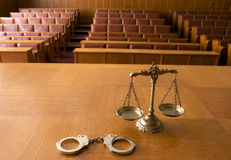 Decorative Scales of Justice and handcuffs. Symbol of law and justice in the empty courtroom, law and justice concept Royalty Free Stock Photography