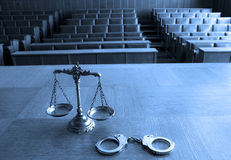 Decorative Scales of Justice and handcuffs. Symbol of law and justice in the empty courtroom, law and justice concept, BLUE TONE Stock Photos