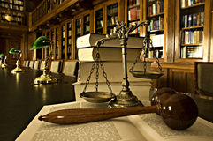 Decorative Scales of Justice in the library Royalty Free Stock Image