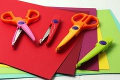Decorative scissors and cartons stock photo