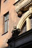 Decorative sculptural elements on the facade of the old building. Stock Photography