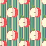 Decorative seamless background with stripes and apples. For design Stock Photos