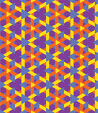 Decorative seamless geometrical pattern of colorful triangles on violet background Royalty Free Stock Photography