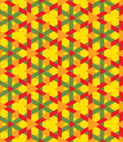 Decorative seamless geometrical pattern of green, orange and red triangles on yellow background Stock Photo