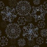 Decorative seamless pattern of golden snowflakes on a black background. Background of snowflakes can be used for textiles. Wrapping paper, background for web Royalty Free Stock Images