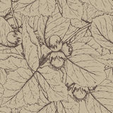 Decorative seamless pattern with hazelnuts and leaves. Stock Photo