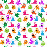Decorative seamless pattern with multi-colored monsters Stock Images