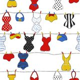 Trendy vector seamless pattern with cute swimsuits. Decorative seamless pattern with swimsuits. Brush painted swimwear, trendy texture. Hand drawn endless stock illustration