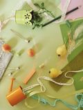 Decorative seasonal composition of fruit, decor, greenery on green tinted paper stock photo