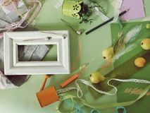 Decorative seasonal composition of fruits, decor, greens and a white frame on green toned paper stock photos