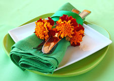 Decorative serviettes with flatwares and marigolds Royalty Free Stock Photos
