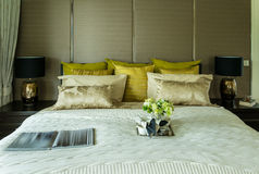 Decorative set on the luxury bed Stock Images