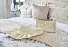 Decorative set with vintage bag and hat on bed in luxury bedroom Stock Photos