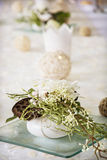 Decorative setting of flowers and candlestick on the banquet tab Royalty Free Stock Photos