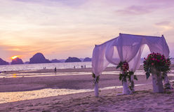 Decorative setting for wedding ceremony on the beach. With sunset as a background Royalty Free Stock Images