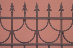 Decorative Sharp bronze fence isolated on brown. Background Stock Photos