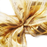 Decorative shiny gold ribbon tied in a bow Royalty Free Stock Image