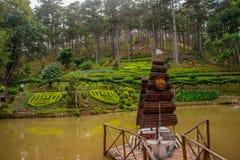 Decorative ship, beautiful flower beds, pond. Vietnam, Dalat. Royalty Free Stock Photo