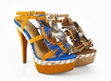 Decorative shoes. Decorative yellow shoes on a white background royalty free stock image