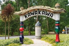 Decorative signpost on the outskirts of Kawakawa, New Zealand. This ornate sign welcomes visitors to the town of Kawakawa, in the Bay of Islands, New Zealand Stock Images