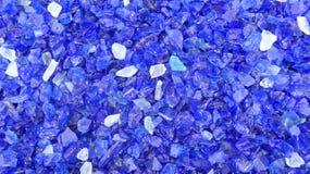 Decorative small blue shards of glass, close-up. Decorative small blue shards of glass as a background stock photos