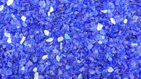 Decorative small blue shards of glass, close-up. Decorative small blue shards of glass as a background royalty free stock image